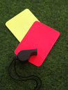 Whistle on yellow and red cards Royalty Free Stock Image