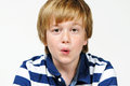 Whistling boy cute teenager on a white background Royalty Free Stock Photo