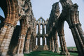 Whitby abbey castle a ruined benedictine sited on s east cliff in north yorkshire on the north east coast of england Stock Images