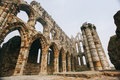 Whitby abbey castle a ruined benedictine sited on s east cliff in north yorkshire on the north east coast of england Royalty Free Stock Images
