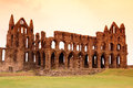 Whitby abbey castle ruined benedictine sited on s east cliff in north yorkshire on the north east coast of england uk Royalty Free Stock Images