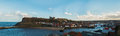 Whitby yorkshire england panoramic view of the town harbour and hillside with st mary s church Stock Image