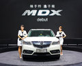 White acura mdx a with models in auto show guangzhou Royalty Free Stock Photo