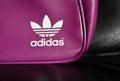 White Adidas logo on fashion leather bag Royalty Free Stock Photos