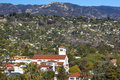 White adobe methodist church houses mountain santa barbara alifo abobe steeple suburbs california Stock Photos