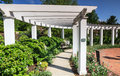 White arbor hershey gardens pennsylvania wooden outdoor surrounded by garden flowers in children s play area of in Royalty Free Stock Photos
