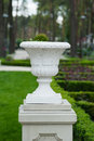 White architectural vase on a pedestal in the park Royalty Free Stock Photo