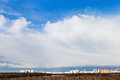 White arcus cloud in weather front under city Stock Photography