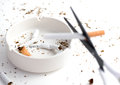 White ashtray with destroyed cigarette that emphasize words `i quit` Royalty Free Stock Photo