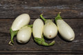 White aubergines on an old wooden textural background Royalty Free Stock Photo