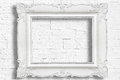 White baroque frame on modern brick wall Stock Images