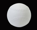 White baseball on black background Stock Images