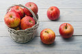 White basket with apples Zdjęcia Royalty Free