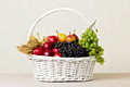 White basket with grapes, apples and pears. Royalty Free Stock Photo