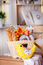 White basket with a variety of bread and tulips in interior Stock Photo