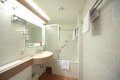 White Bathroom with mirror, sink Royalty Free Stock Images