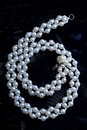 White beads on a black cloth Royalty Free Stock Photo