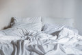 White bedding sheets and pillow messy bed concept close up Royalty Free Stock Photography