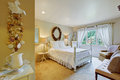 White bedroom interior in old fashion style with antique wooden bed Stock Photo