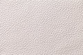 White beige leather texture background with pattern, closeup.