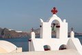 White belfry with blue sky in background santorini island greece Royalty Free Stock Images