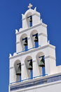 White bell tower of a church St. Irene of Oia, San Stock Photos