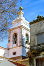 White bell tower in lisbon portugal the alfama district Royalty Free Stock Photography