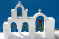 White bell tower at oia over the sea santorini cyclades greece Royalty Free Stock Photo