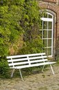 White bench beside building Royalty Free Stock Photography