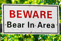 A white beware bear in area sign Royalty Free Stock Photo