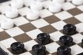 The White and black checkers on the Board Royalty Free Stock Photo