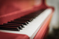 White and black keys of red piano Royalty Free Stock Photo