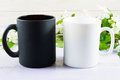 White and black mug mockup with apple blossom Royalty Free Stock Photo