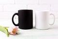 White and black mug mockup with  pink tulip Royalty Free Stock Photo