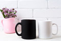 White and black mug mockup with purple flowers in polka dot pink Royalty Free Stock Photo