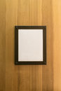 White blank empty brown photo Frame on wooden wall. Background, Wallpaper. Royalty Free Stock Photo