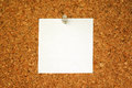 White blank paper for your text on cork background Royalty Free Stock Image