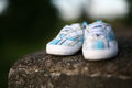 White blue baby shoes on the rock Stock Photo