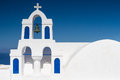 White blue bell tower at oia santorini greece Royalty Free Stock Photo