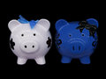White blue and black piggy bank banks on background Stock Photography