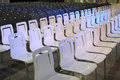 White and blue chairs in rows Stock Image