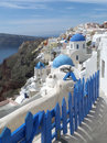 White and blue Greek Islands traditional churches architecture at Oia village, Santorini island Royalty Free Stock Photo