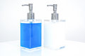 White and Blue liquid soap in transparent bottle Royalty Free Stock Image
