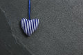 White Blue Stripes Love Valentine's heart hanging on grey slate Royalty Free Stock Photo