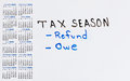 White board with calendar marked for tax situations on concept either a refund or owe Stock Photo