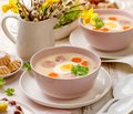 White borscht, polish Easter soup with the addition of white sausage and a hard boiled egg in a ceramic bowl. Royalty Free Stock Photo