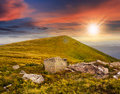 White boulders on the hillside at sunset composit landscape with sharp near mountain peak in light Stock Photography