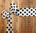 White bow with black dot Royalty Free Stock Images