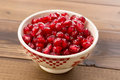 White bowl filled beautiful ruby red pomegranate seeds Royalty Free Stock Photos