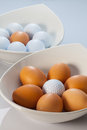 White bowls, easter eggs and golf balls Royalty Free Stock Image